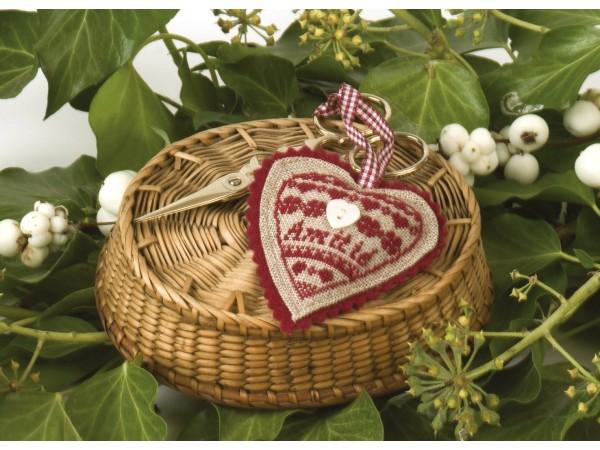 Coussin ciseaux coeur rouge